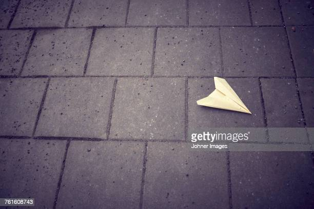 Paper airplane on pathway