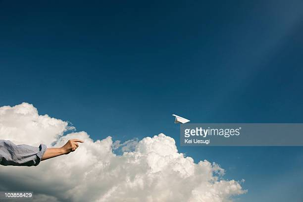 a paper airplane. - paper airplane stock pictures, royalty-free photos & images