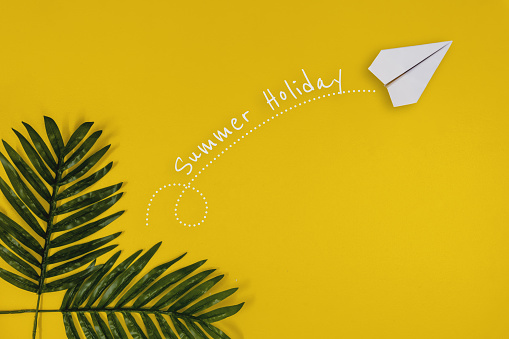 Paper Airplane Summer Holiday Concept on Yellow Background - gettyimageskorea