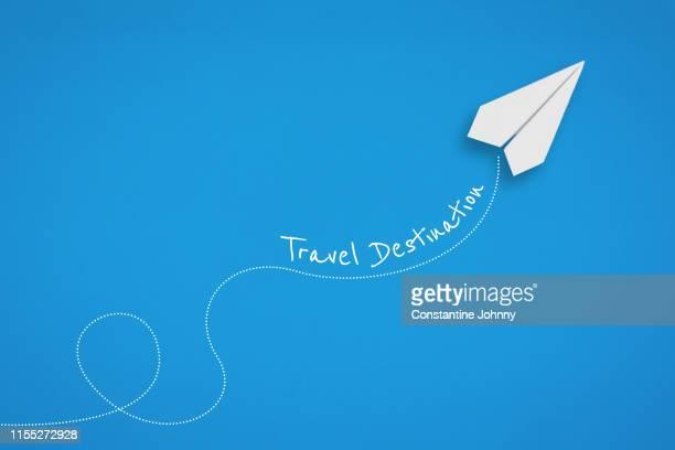 paper airplane travel destination concept on blue background. - aeroplano di carta foto e immagini stock