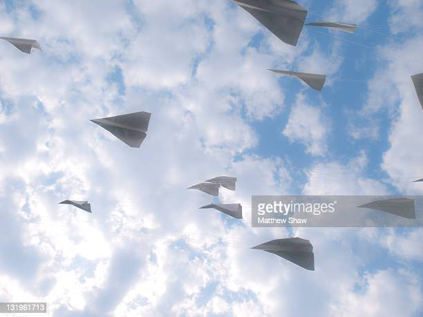 paper airplanes - paper airplane stock pictures, royalty-free photos & images