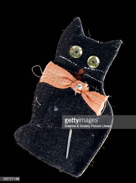 Paper amulet in the shape of a black cat England c1918 Paper amulet in the form of a seated black cat worn by a soldier during First World War London...