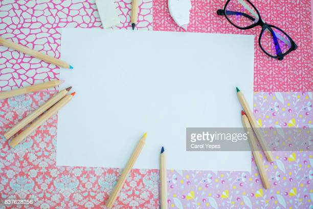 paper and color pens in pink background - colouring book stock photos and pictures