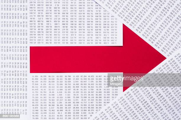 paper and data composing red arrow - arrow stock photos and pictures