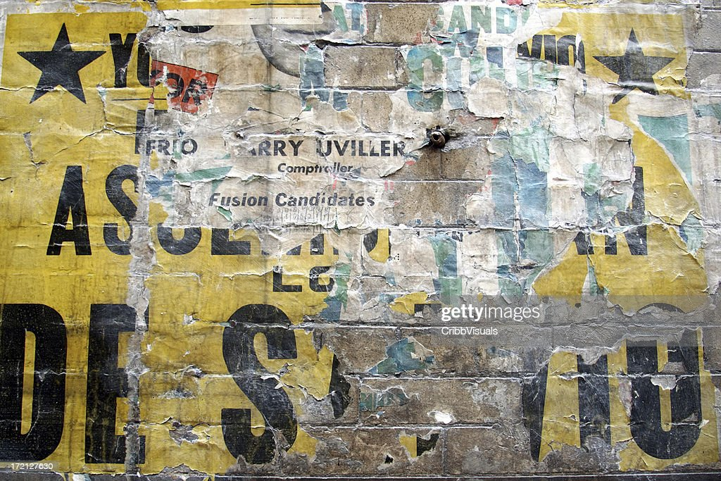 Paper background with billboard posters ripped up : Stock Photo