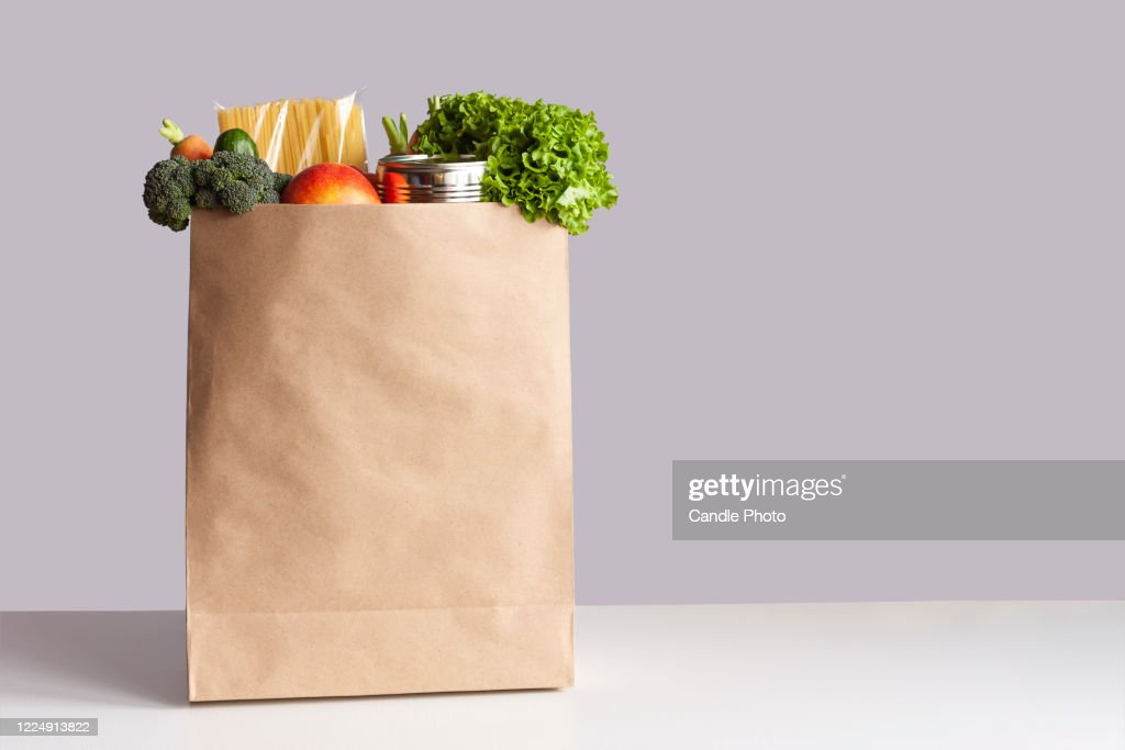 Paper bag with food gray background : Stock Photo