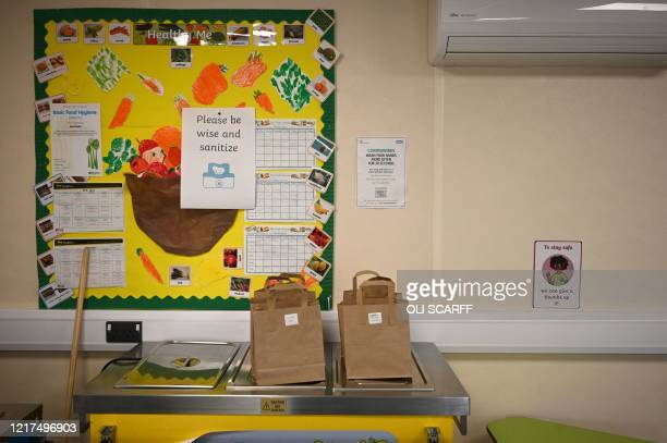 Paper bags containing children's lunches are seen ready for collection in a teaching environment safe from Coronavirus for pupils and teachers at...