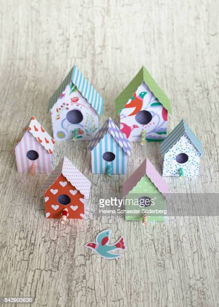 paper birdhouses in different patterns - birdhouse stock photos and pictures