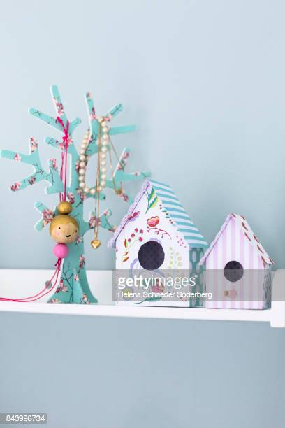 Paper birdhouses in different patterns