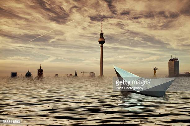 Paper boat adrift in a flooded Berlin