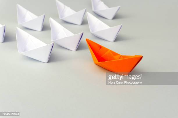 paper boat business leadership concept - 先導 ストックフォトと画像