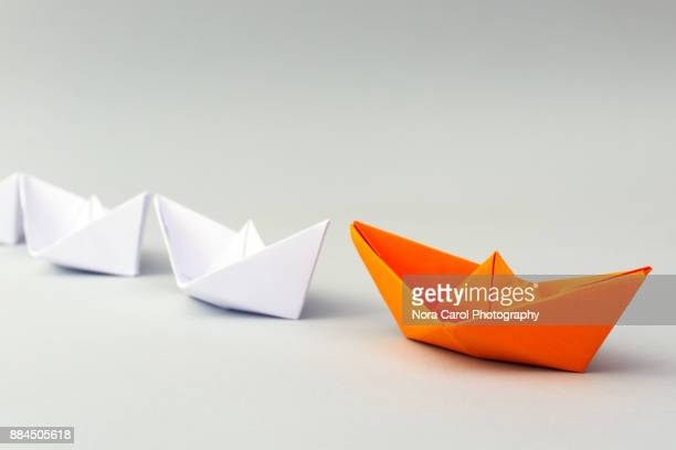 paper boat business leadership concept - following stock pictures, royalty-free photos & images