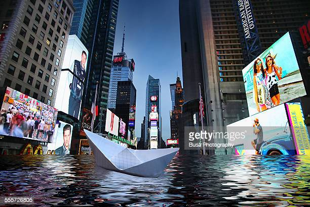 Paper boat floating in a flooded Times Square, NYC