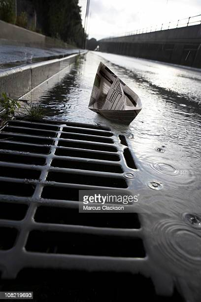 Paper Boat Heading for Drain