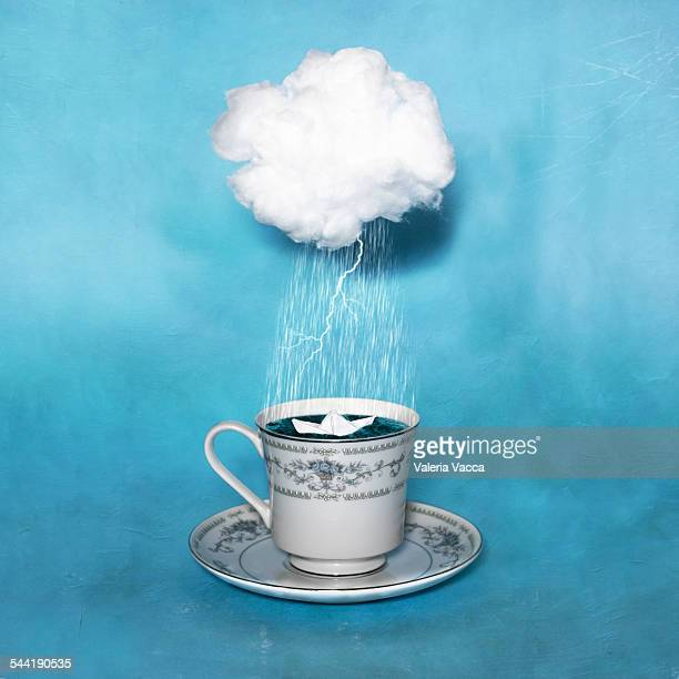 Paper boat in a teacup during a thunderstorm