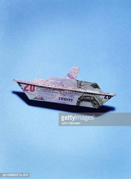 Paper boat made from twenty pound banknote