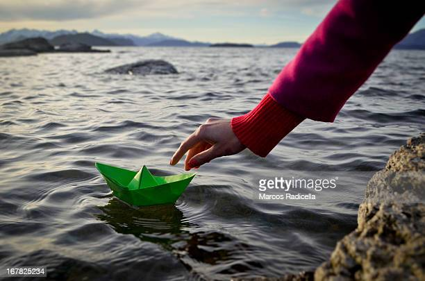paper boat on big lake - radicella stock photos and pictures