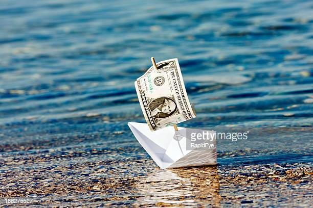 Paper boat with $1 sail stuck in shallows: money problems?