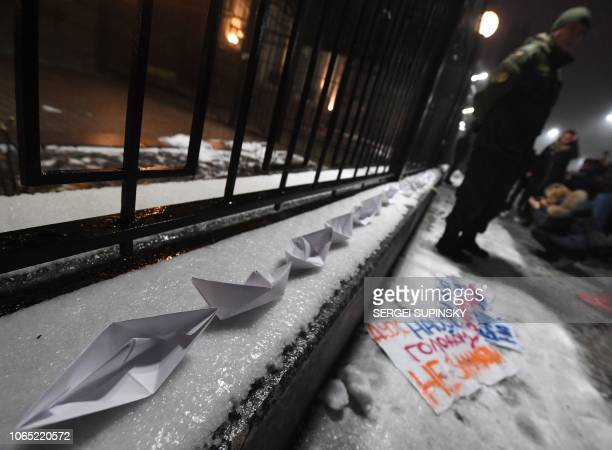 Paper boats are seen in front of the Russian Embassy in Kiev late on November 25 during a protest following an incident in the Black Sea off...