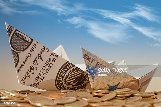 Paper boats on the coin heap