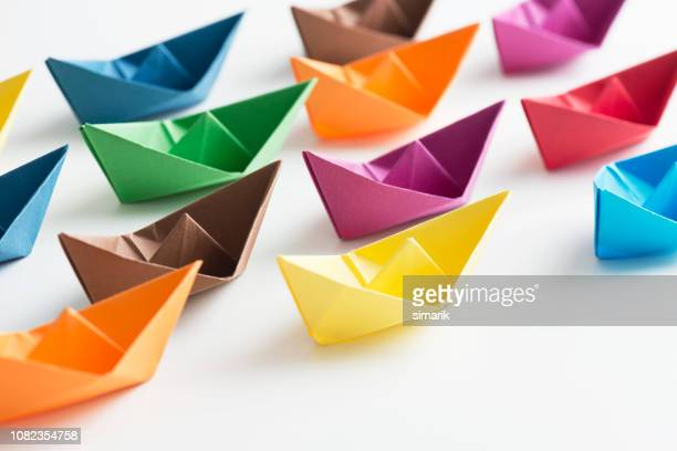 paper boats - variation stock pictures, royalty-free photos & images