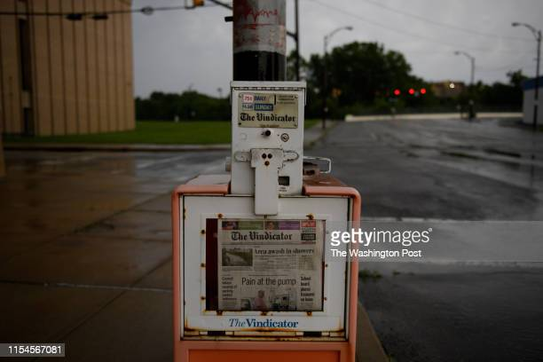 A paper box outside The Vindicator in Vindicator Square in the rain on July 2 2019