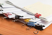 Paper business documents with color clips