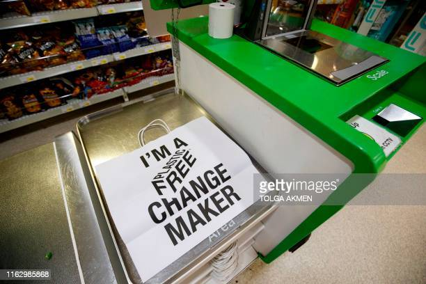 Paper carrier bag promoting the use of plastic-free packaging is seen at Budgens supermarket in Belsize Park, north London on July 2, 2019. - British...