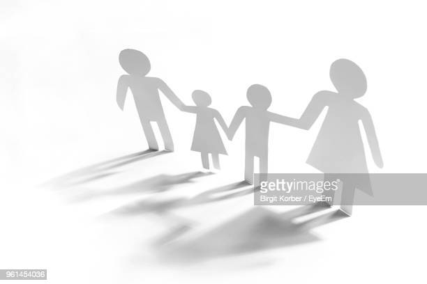 paper chain of family over white background - human representation stock pictures, royalty-free photos & images