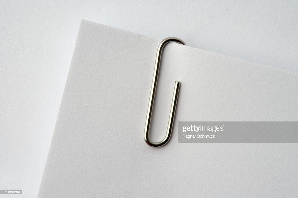 Paper clip on corner of paper : Stock Photo