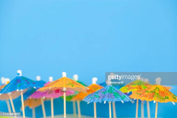 paper cocktail umbrellas - novelty item stock pictures, royalty-free photos & images