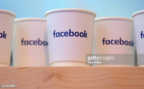 Paper coffee cups adorned with the Facebook logo stand at the Facebook Innovation Hub on February 24 2016 in Berlin Germany The Facebook Innovation...
