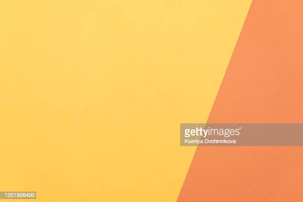 paper color yellow, orange abstract background. - lilac fashin stock pictures, royalty-free photos & images