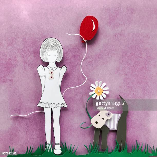 Paper craft picture of a girl holding a red balloon with a little dog holding a daisy in its mouth