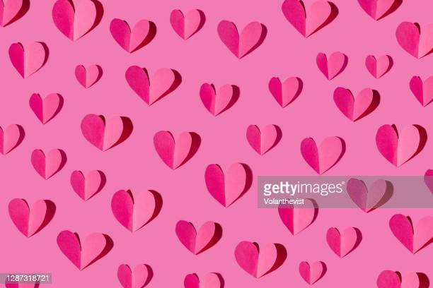 paper craft with heart pattern on pink background - love stock pictures, royalty-free photos & images