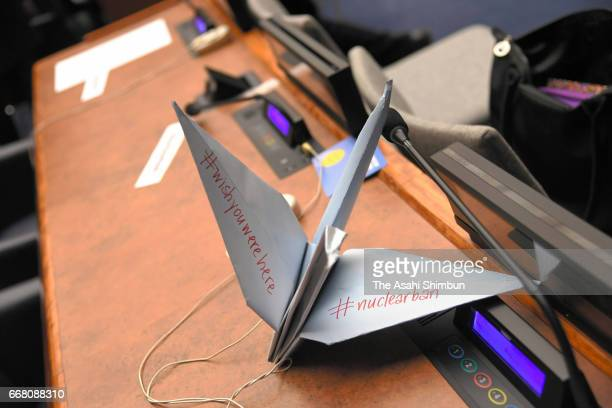 A paper crane is placed at the desk of Japanese delegation after Japan cancelled participation of the nuclear ban treaty discussion at the United...