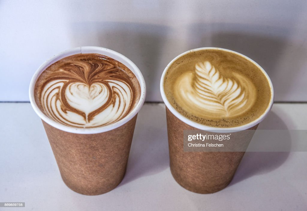 Paper cup with cocoa and latte coffee to go in front of a cafe in San Francisco : Stock Photo