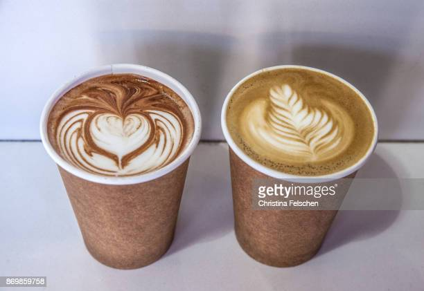 paper cup with cocoa and latte coffee to go in front of a cafe in san francisco - christina felschen stock photos and pictures