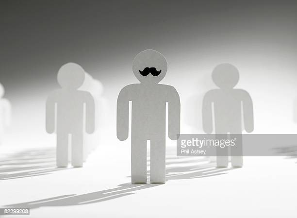 paper cut out of a leader with a mustache