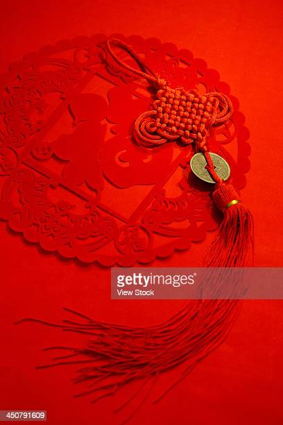 paper cut-out and chinese knot - chinese knotting stock pictures, royalty-free photos & images