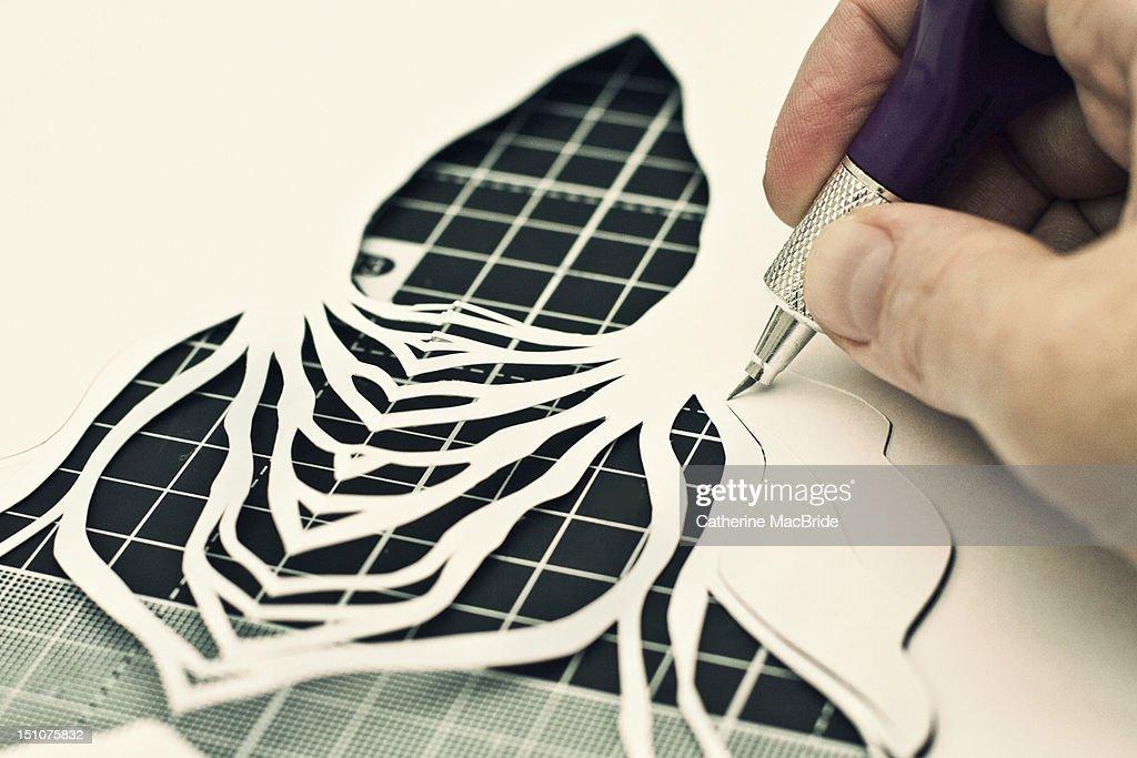 Paper cutting in progress : Stock Photo