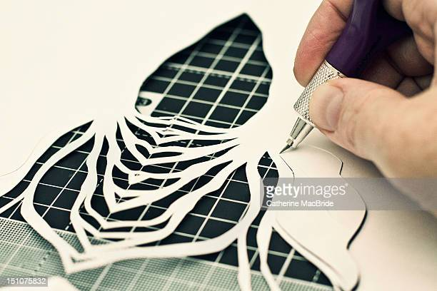 paper cutting in progress - catherine macbride stock photos and pictures