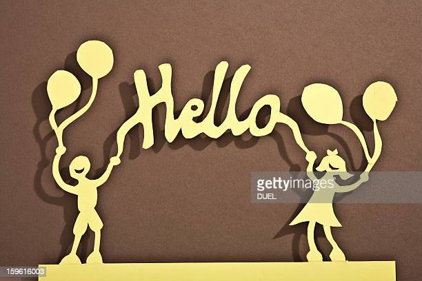 Paper dolls of holding balloons and a hello sign