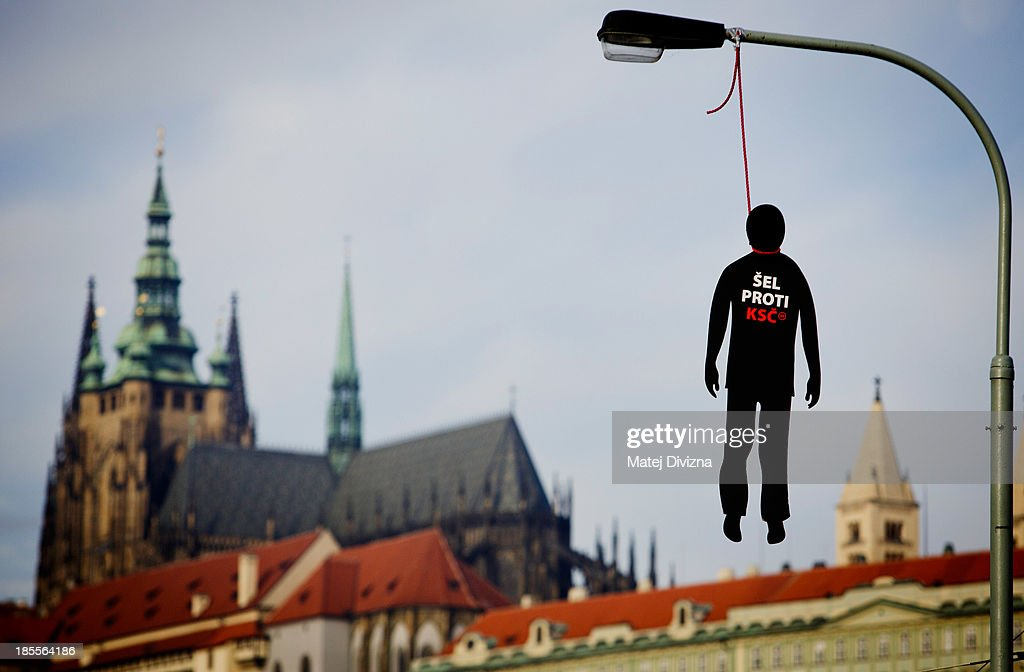 A paper dummy with a red noose with the sign 'Went against KSC' hangs from a lamp-post on October 22, 2013 in Prague, Czech Republic. KSC is an abbreviation for the Czechoslovakia Communist Party and KSCM is the name of the current Communist Party of Bohemia and Moravia. The dummies symbolize the people who were executed during the communist regime before the Velvet revolution in 1989 and appear to be a warning about the possible rise of communist power after the Czech early election which is being held on October 25 and 26. Pre-election polls show the Communist Party is in second or third place.