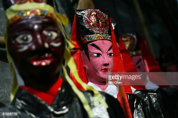 Paper effigies of the ghosts are displayed during the Bun Festival at Cheung Chau island on May 12 2008 in Hong Kong China The 2008 Cheung Chau Bun...