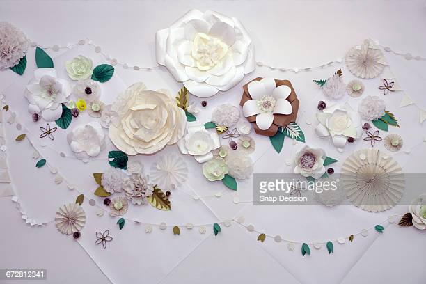 Paper flowers decorate a wall