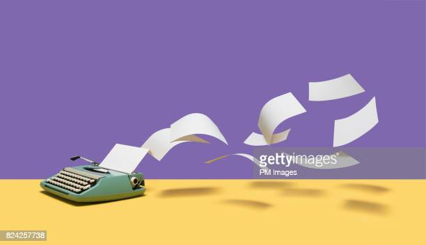 paper flying out of manual typewriter - fliegen stock-fotos und bilder