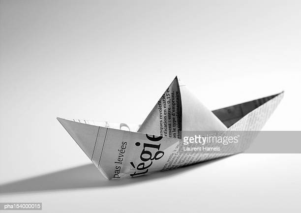 Paper folded into shape of boat, b&w.
