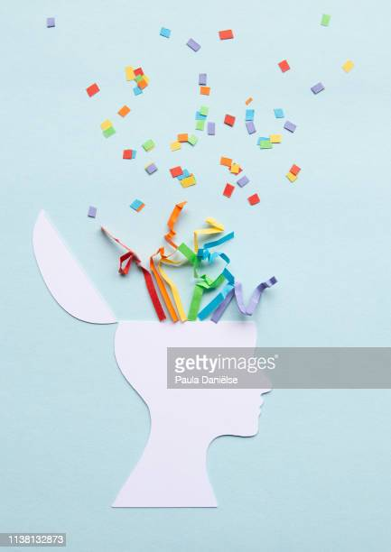 paper head with exploding rainbow - creativity stock pictures, royalty-free photos & images