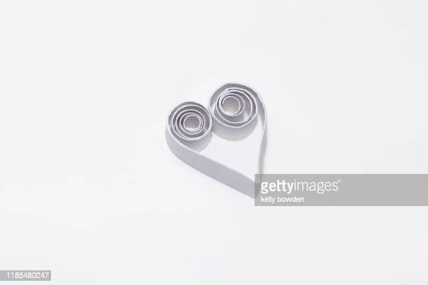 paper heart - kelly bowden stock pictures, royalty-free photos & images
